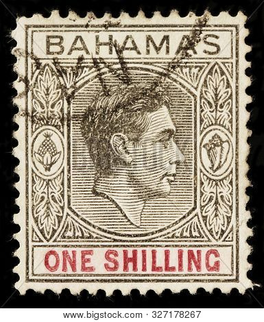 Luga, Russia - October 05, 2019: A Stamp Printed By Bahamas Shows Portrait Of George Vi -  King Of T
