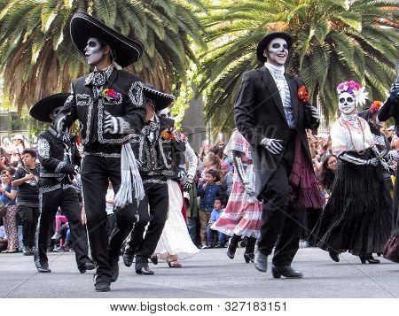Mexico City, CDMX / Mexico - 29 10 2016: Day of the Dead Parade in Avenida Reforma with original cha