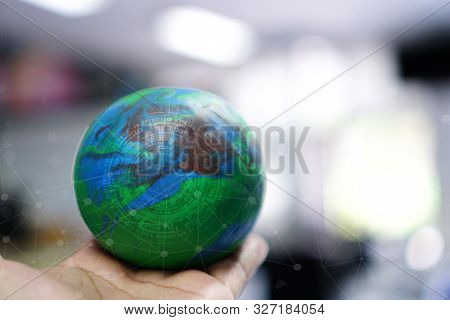 Businessman Holding Earth Globe Model With Radar Network In Hands. Concept For Iot Global Business,