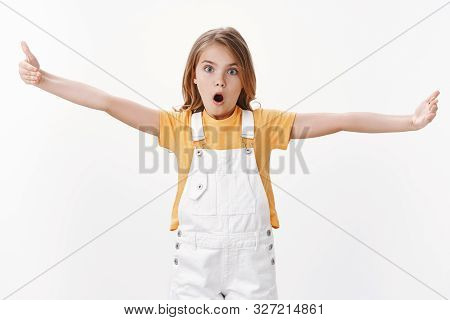 Impressed Fascinated Cute Clever Blond Girl Explain Something Big, Stretch Hands Showing Huge Enormo