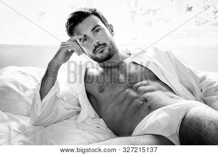 Sexy Hairy Muscular Man With Beard Lying In Bed In Underwear And Open Shirt Revealing Sixpack Abs An