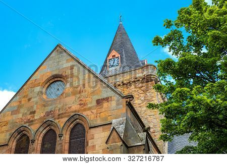 Dornoch, Scotland, Upward View Of The Facade Of The Famous Ancient Cathedral In The Country Center
