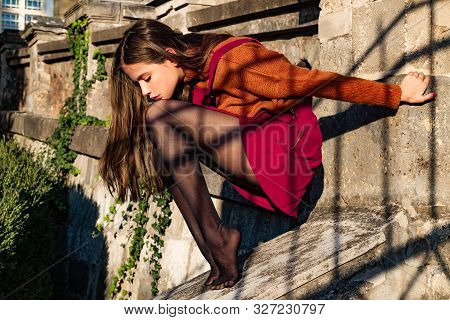 Shopping Inspiration. Atractive Dreamy Thoughtful Brunette Sitting Without Shoes. Thinking About Gir