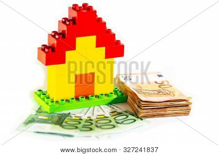 House Model With Stack Of A Euro Banknote, Money.
