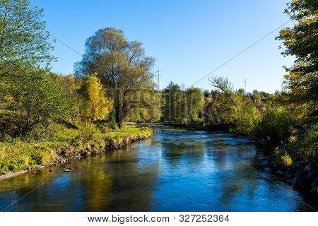 Scenic View Of  Olt River At Autumn In Transylvania, Romania