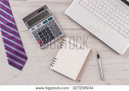 Calculator And Planner In Focus. Entrepreneurs Set. Business Plan Development And Expenditures Calcu