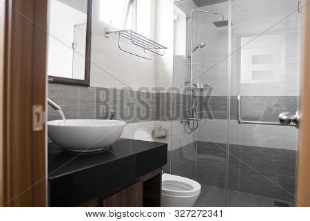 Bathroom Interior With White Round Sink And Chrome Faucet In A Modern Bathroom With A Toilet And Sho