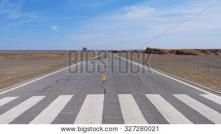 Nature Landscape View Of Straight Road In Under Sunny Blue Sky In Dunhuang Unesco Global Geopark, Ga