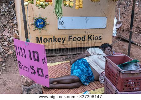 Chon Buri, Thailand - March 16, 2019: Homeless Obese Woman Sleeps On Mat On Ground In Front Of Burap