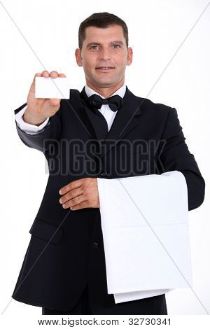 Waitor holding business card