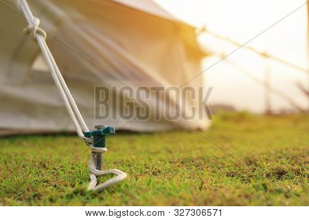Close Up Of Tent Peg Anchor On The Ground   Tent,hook Of Tent,camping