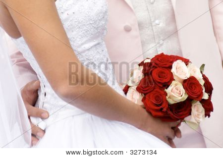 Bride With Bouquet Red And Rose Flowers