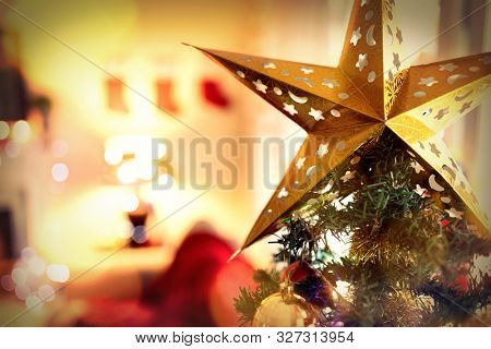 Composite image of brown parquet against christmas tree at home at christmas time