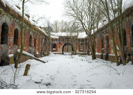 The Ruins Of The Old Barracks About The Artillery Fort , Cloudy February Day. Kronshtad, Russia