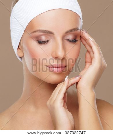 Beautiful face of young and healthy woman. Skin care, cosmetics, makeup, complexion and face lifting. poster