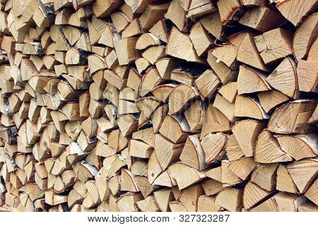 Woodpile Of Birch Wood, Background Of Logs. Harvesting Wood For The Winter. Natural Backdrop. Chop F