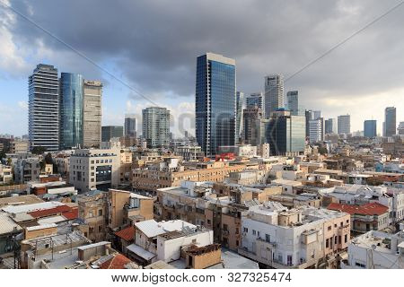 Skyline Panorama Of City Tel Aviv With Some Dark Storm Clouds And Urban Skyscrapers In The Morning,