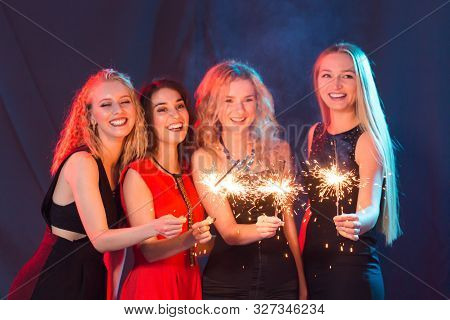 Birthday Party, New Year And Holidays Concept - Group Of Female Friends Celebrating Holding Sparkler