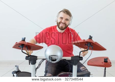 Drummer, Drum, Music And People Concept - Young Man Drummer Playing In The White Room