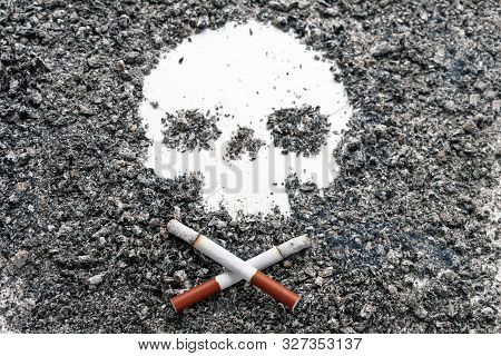 Two Crossed Bone-shaped Smoking Cigarettes Lie Next To A Skull Formed By Tobacco Ash. Jolly Roger. C
