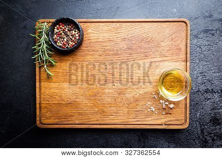 Cutting Board, Seasonings And Oil Set On Dark Background, Top View, Copy Space