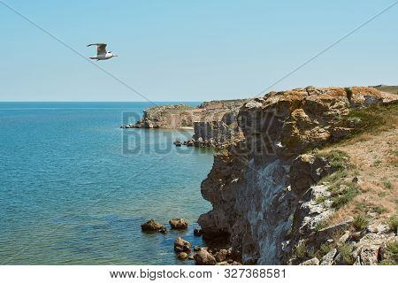 Scenic View Of Huge Cliffs And Sea. Dangerous Rocky Cliffs Jagged To Ocean. Peaked Rocks And Cliffs