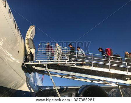 Jackson, Wy, 8/28/9019: Passengers Are Boarding A Delta Airlines Flight Via Ramp.