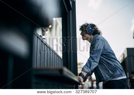 Cheerfulyoung Guy Near Stall In City Stock Photo