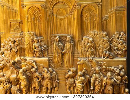 Florence, Italy - May 31, 2019: King Solomon Meets The Queen Of Sheba - One Of Ten Bronze Panels On