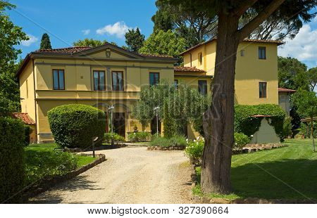 Florence, Italy - May 31, 2019: The Hotel Villa Betania Sits On A Shaded Property In A Residential A