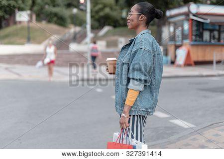 Happy Girl Enjoying Coffee Outdoors Stock Photo