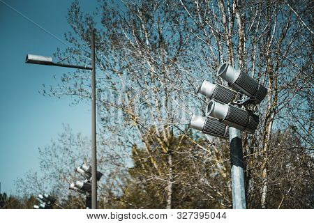 Four Powerful Spotlights Directed Upwards As A Part Of Landscape Lighting Equipment Installation Out