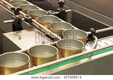 Conveyor Belt In Motion At Production Of Canned Food In Tin Cans.