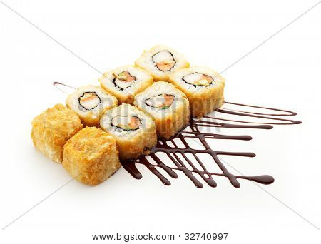 Maki Sushi - Roll with Cream Cheese, Fresh Raw Salmon and Avocado inside. Tobiko (flying fish roe) outside.