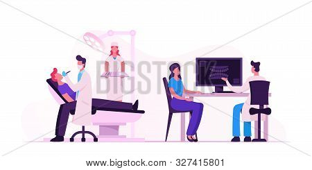 Man Lying In Medical Chair In Stomatologist Cabinet With Equipment. Doctor Conducting Patient Health