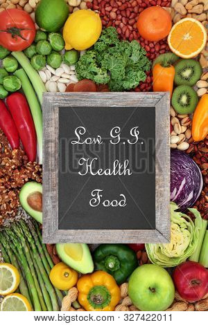 Low GI health food for diabetics also high in antioxidants, anthocyanins, vitamins, minerals, smart carbs & omega 3 fatty acids. Below 55 on the GI index. Top view with blackboard title.