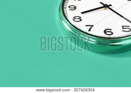 Part Of Analogue Plain Wall Clock On Trendy Pastel Green Background. Eight Thirty Oclock. Close Up W