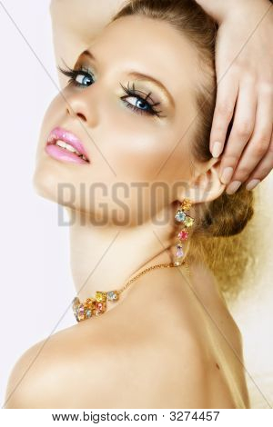Blond Woman With Necklace And Smile