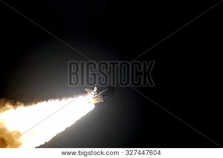 The Launch Of A Space Rocket At Night, In A Dark Sky. Copy Space Elements Of This Image Were Furnish