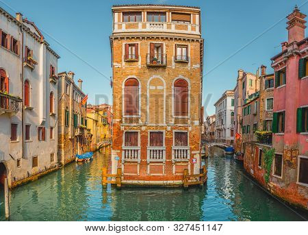 View Of The Street Canal In Venice, Italy. Colorful Facades Of Old Venice Houses Standing In Water.