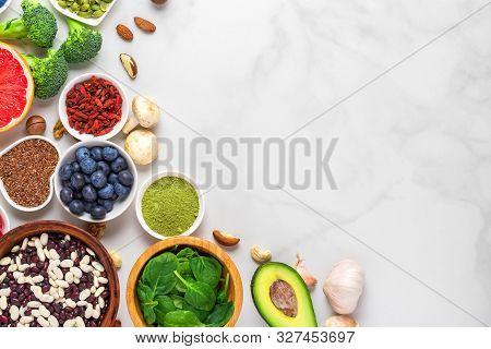 Healthy Vegan Food Clean Eating Selection: Fruit, Vegetable, Seeds, Superfood, Nuts, Berries On Whit