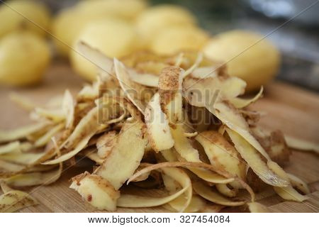 Potato Peels, Peeling A Stack Of Potatoes With Peels In Foreground