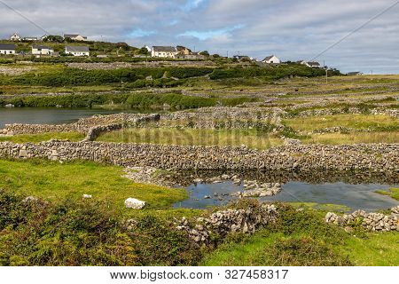 Farm With Rock Walls, Lake And Fields In Inisheer Island