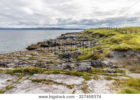 Rocks And Field In Inisheer Island With Burren In Background