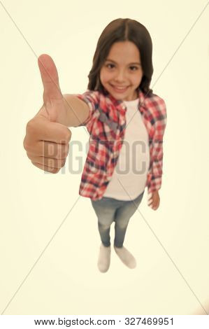 Kid Girl Long Curly Hair Posing Confidently. Girl Smiling Face Feels Confident. Child Confidently Sh