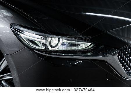 Novosibirsk, Russia - October 04, 2019:  Mazda 6,black Car Headlights. Exterior Detail. Close Up Det