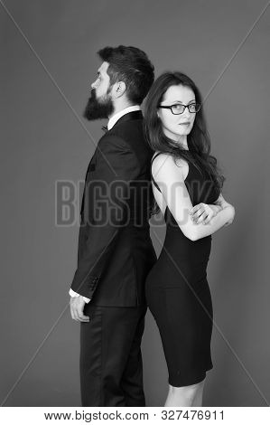 Man Bearded Hipster And Woman In Formal Dress Red Background. Formal Fashion And Elegant Clothes. Lu