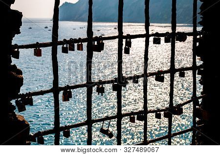 Monterosso Al Mare, Italy - September 02, 2019: Love And Marriage Locks Hanging On A Metal Window Gr