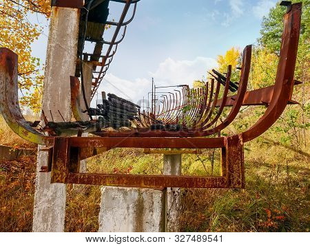 Ruins Of The Chute Of Old Abandoned Wooden Luge Track With Steel Framework In Autumn, Ukraine