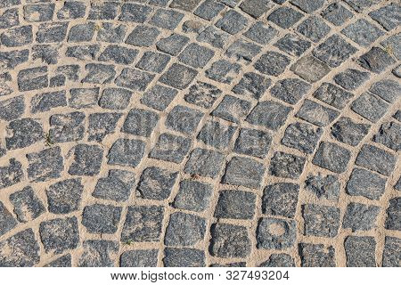 Cobbled Road Close-up. Pedestrian Paving In Street. Paved, Detail. Brown Texture Of A Paving Stone T